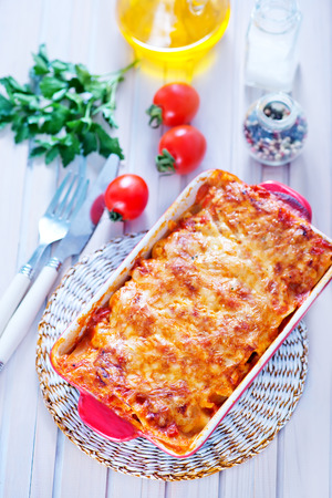 lasagna in bowl and on a table