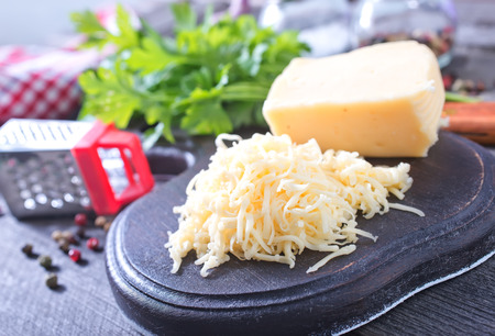 cheese on board and on a table photo