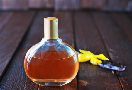 traquility: perfume in bottle and on a table