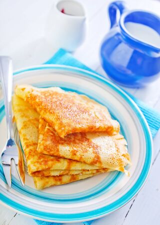 pancakes on plate and on a table Stock Photo