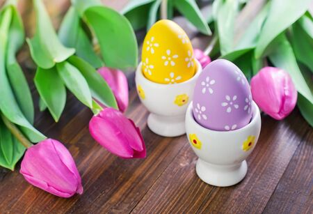 easter eggs on the wooden table, color eggs photo