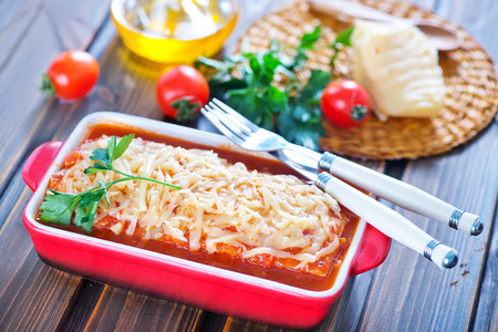 lasagne with meat and cheese in the bowl photo
