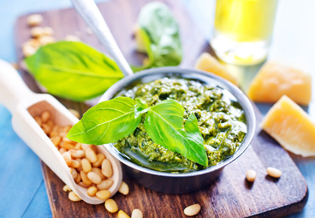 pesto sauce in bowl and on a table