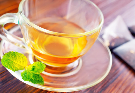 basswood: mint tea in cup and on a table