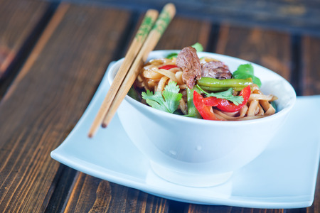 cow pea: noodles with sauce and fried meat  in bowl