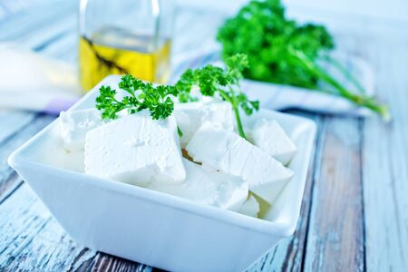 feta cheese in bowl and on a table photo