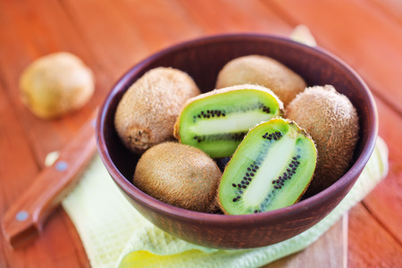 kiwi in bowl and on a table photo