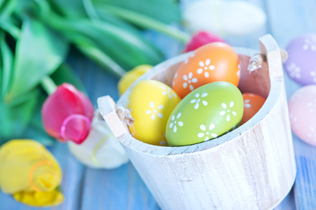 easter eggs and flowers on a table photo