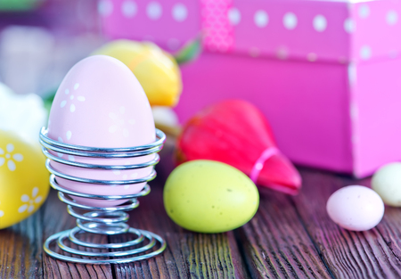 easter eggs and box for present on a table photo