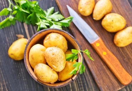 raw potato: sliced raw potato on the kitchen table