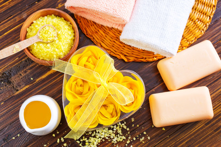 spa objects: spa objects on the wooden table, sea salt and soap Stock Photo