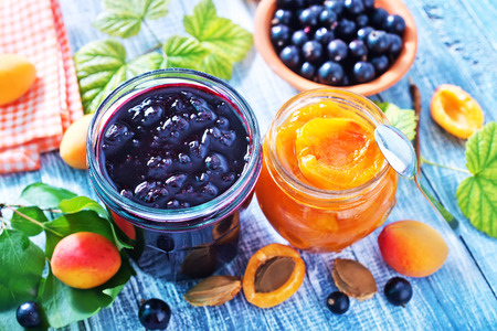 jam jar: sweet jam in glass bank and on a table