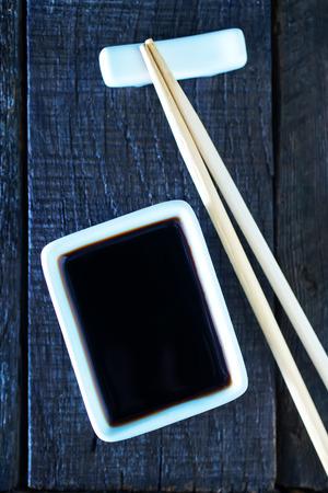 hoisin sauce: soy sauce and bamboo sticks on a table