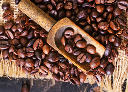 coffeetree: coffee beans on the wooden table, roast coffee beans