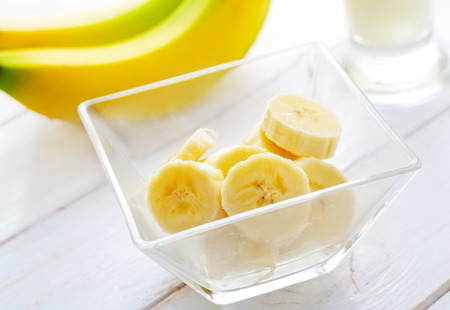Fresh banana in the glass bowl, banana and milk Imagens - 38134905
