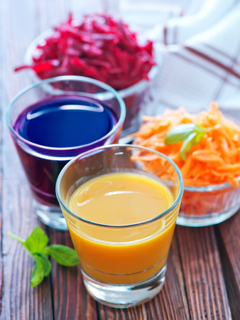 beet juice: carrot juice and beet juice in the glasses Stock Photo