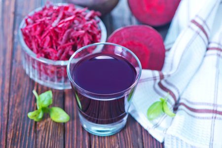 beet juice: beet juice in glass and on a table