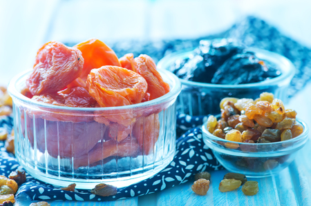dry fruits in bowl and on a table photo