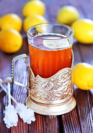 salubrious: fresh tea with lemon in cup and on a table