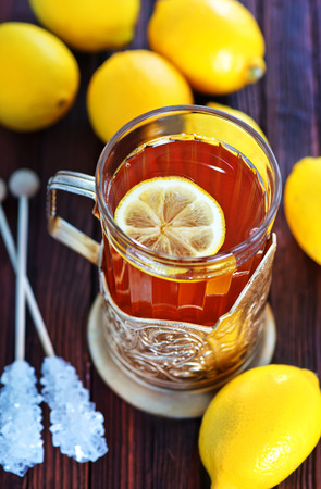 stimulated: fresh tea with lemon in cup and on a table