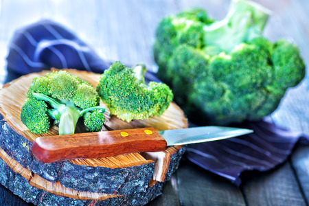 brocoli: raw brocoli and knife on the wooden background