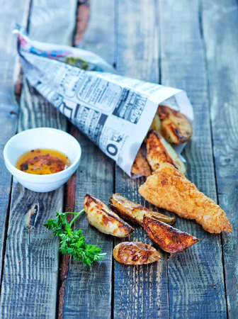 fish and chips on the wooden table
