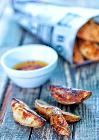 british cuisine: fish and chips on the wooden table