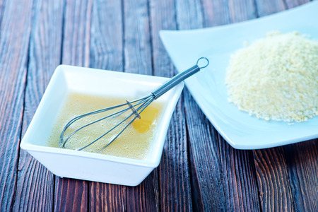 single whip: raw egg and whisk in white bowl