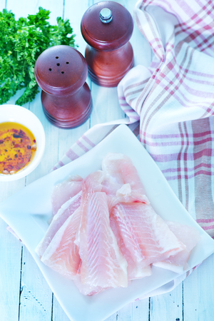 raw fish and spice on a table photo