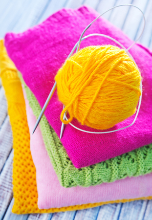 knitting on the wooden table, color threads photo