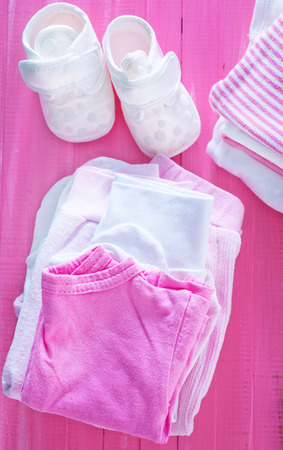 baby clothes on the table, clothes for girl photo