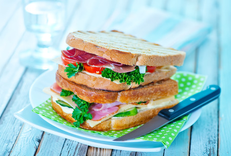 dinner plate: sandwiches with ham and cheese on the plate