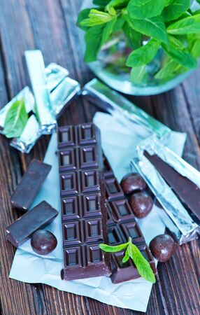 endorphines: chocolate and mint leaf on the wooden table