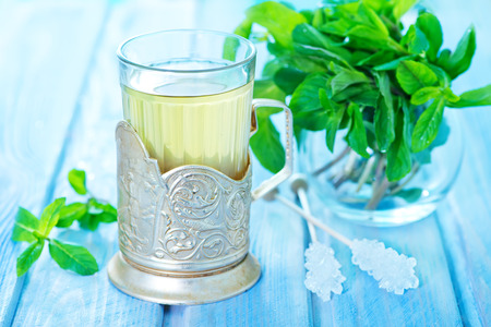 mint tea in glass and on a table photo