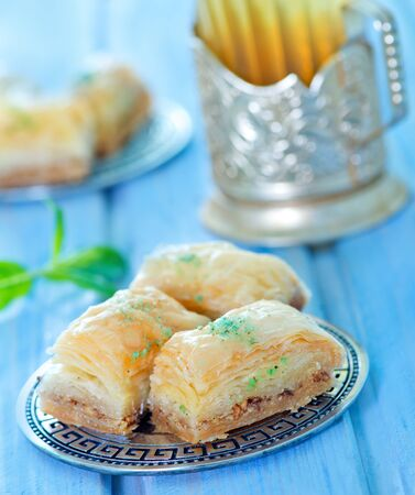turkish dessert: Baklava, Turkish dessert on metal plate and on a table