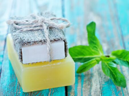 well made: soap and mint leaves on a table
