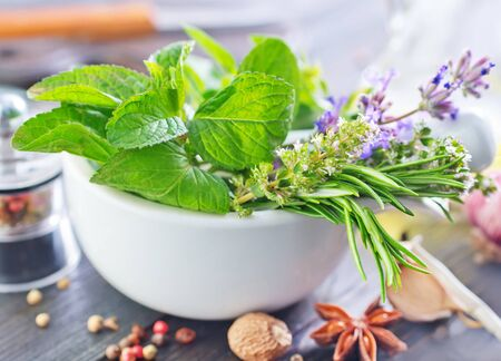 aroma bowl: herb and aroma spice in bowl and on a table