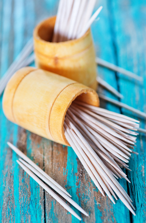 blanking: wooden toothpicks on the green table,  toothpick on wooden backgrounds
