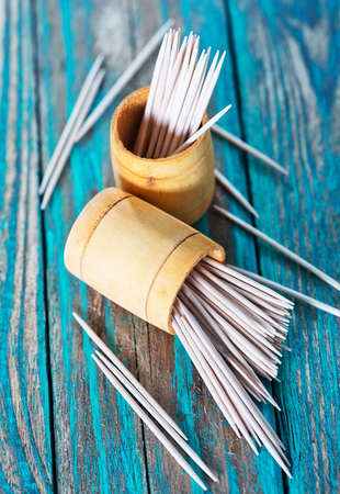 cooking implement: wooden toothpicks on the green table,  toothpick on wooden backgrounds