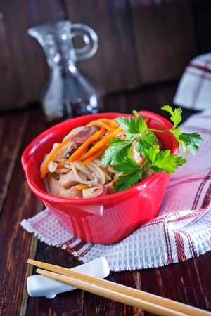 rice noodles: rice noodles with meat and vegetables in bowl