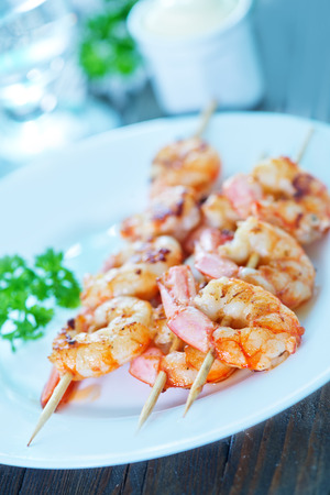 caterers: shrimps on plate and on a table Stock Photo