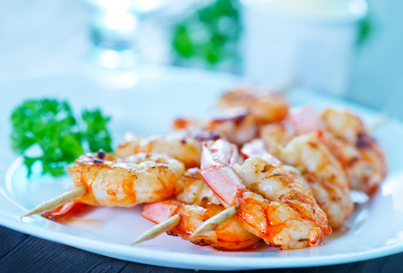 shrimp: shrimps on plate and on a table Stock Photo