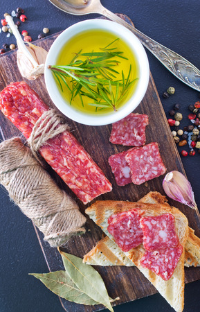 furred: salami and toasts on the wooden board