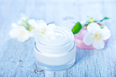 skin care products: cream for body in bank and on a table Stock Photo