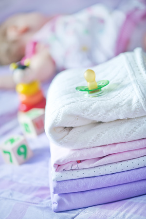 bed clothes: baby clothes on the bed, color baby linen