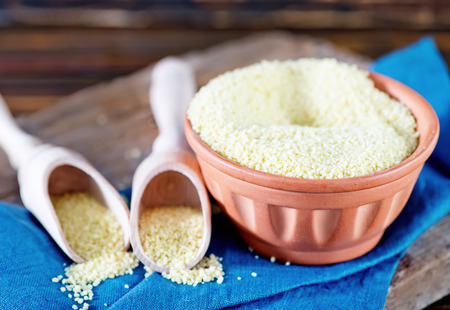 couscous: cous-cous in bowl and on a table Stock Photo