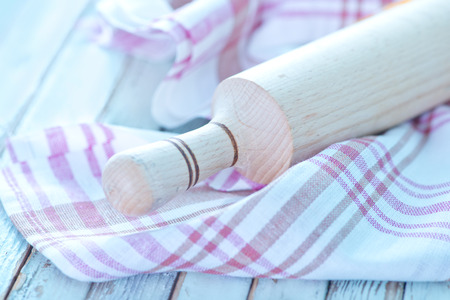 bird       s house: rolling pin and napkin on a table Stock Photo