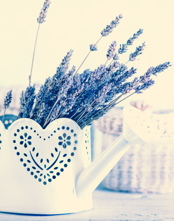 downtime: bouquet of lavender on a white wooden table