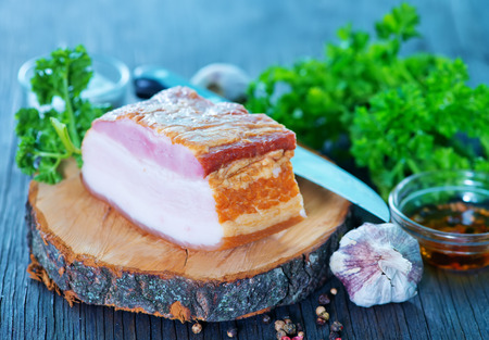 peppered: smoked lard with spice on the wooden board Stock Photo