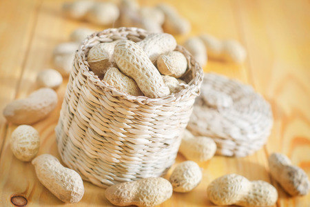 goober peas: nuts in basket and on a table Stock Photo